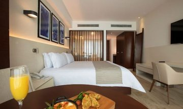 Quarto Altitude by Krystal Grand Punta Cancún All Inclusive -